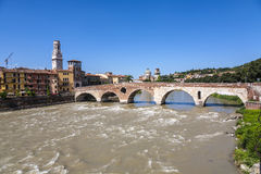 Old roman bridge Ponte di Pietra in Verona  spans the river Etsc Royalty Free Stock Image