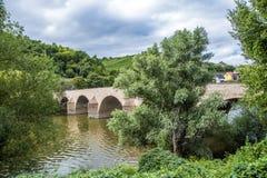 Old roman  bridge spanning the river Nahe Stock Photos