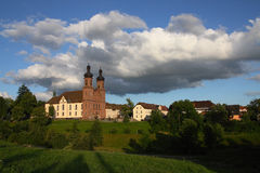 Old Roman Church. In the hills with some village houses  among meadows Royalty Free Stock Photos