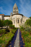 Old roman church and steeple. The roman church and steeple of the 'abbaye aux dames' in Saintes (west of France) seen from the medicinal garden Stock Image
