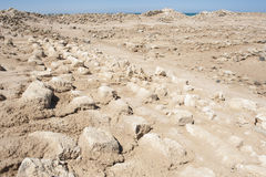 Old roman ruins on desert coastline. Remains of old abandoned roman fort ruins on Red Sea coastline royalty free stock images