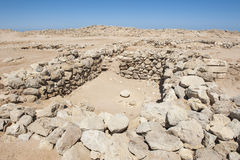 Old roman ruins on desert coastline Stock Images