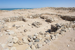 Old roman ruins on desert coastline. Remains of old abandoned roman fort ruins on Red Sea coastline royalty free stock photography