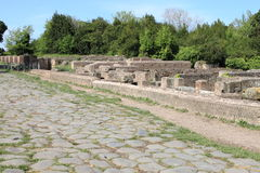 Old roman stony street at Ostia Antica Royalty Free Stock Images