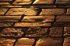 Old Roman street with cobblestones in the town of Rovinj in Croatia. Old Roman street with cobblestone tiles in the small Istrian town of Rovinj in Croatia at Stock Photo