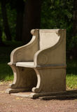 Old roman style armchair in the park Stock Image