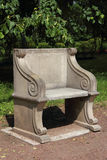Old roman style armchair in the park Royalty Free Stock Photos