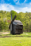 Old Romanian Mill. Landscape shoot in Sibiu, Romania with an old romanian wind mill from the year 1920 Royalty Free Stock Photo