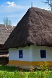 Old romanian traditional village clay and reed house.  stock photos