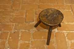 Old romanian traditional wooden stool Stock Photo