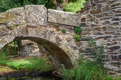 Old romanic stone bridge. Detail of old romanic stone bridge with small arch Stock Images
