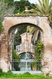 Old romantic archway with flowerpot on the top at the Palatine. Hill, Rome, Italy, Europe stock photos