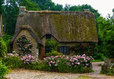 Old romantic house in france with roses royalty free stock photography