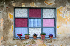 Old romantic windows with flowerpots Royalty Free Stock Images