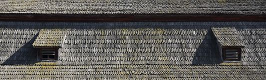The old roof of an ancient barn, created from wooden shards, darkened by weather influence. S stock photography
