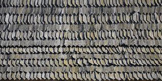 The old roof of an ancient barn, created from wooden shards, darkened by weather influence. S royalty free stock image