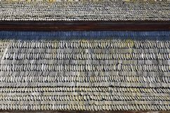 The old roof of an ancient barn, created from wooden shards, darkened by weather influence. S royalty free stock photography