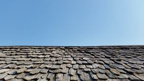 Old roof and blue sky Royalty Free Stock Photos