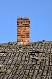 Old roof with brick chimney Stock Images