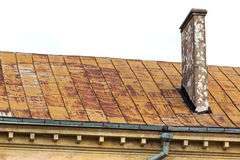 Old roof with chimney Royalty Free Stock Image
