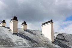 Old roof with chimney Stock Images