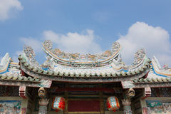 Old Roof Of Chinese Shrine. And Sky stock photo