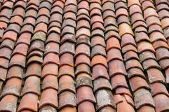 Old roof with colorful ceramic tiles Stock Photo