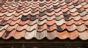 The old roof covered with orange tiles Royalty Free Stock Photography