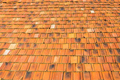 The old roof covered with orange tiles Stock Images