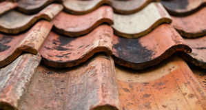 The old roof covered with orange tiles Stock Photography