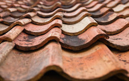 The old roof covered with orange tiles Royalty Free Stock Images
