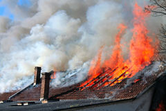 Old roof on fire Royalty Free Stock Photo
