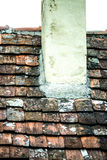 Old roof with medieval roof tiles Stock Photos