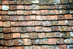 Old roof with medieval roof tiles Stock Images
