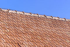 Old roof of orange clay tiles. With blue sky Royalty Free Stock Photography