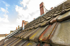Old roof with roofing tiles and chimneys Stock Image
