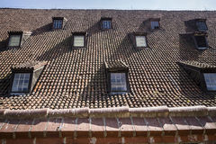 Old roof with small windows Stock Images