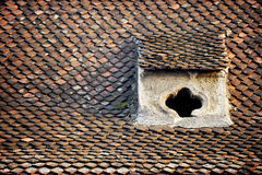 Old roof tile with attic Stock Photos