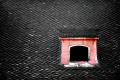Old roof tile and attic window Stock Photography