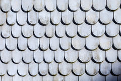 Old roof tile structure in grey. Colors Stock Photos