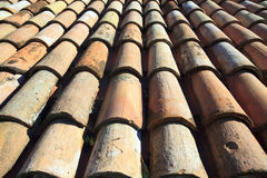 Old roof tiles. Old weathered orange roof tiles Royalty Free Stock Photo