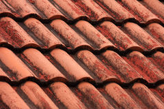 Old roof tiles with blue sky background. Stock Photo