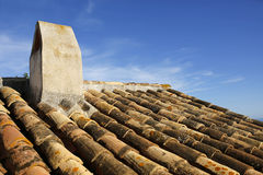 Old roof tiles with chimney Stock Photos
