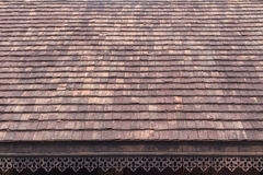 Old roof tiles. Old clay roof tiles with wood eave perforated design Royalty Free Stock Images