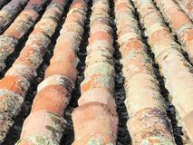 Old roof tiles. Detail of old roof, where the aged and mossy tiles are appreciated. Manzanares el Real Castle. Spain Royalty Free Stock Photo