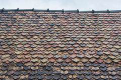 Old roof tiles. Is lichen and roof in should be repair Royalty Free Stock Photos