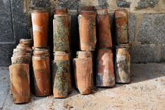 Old roof tiles stored in the street. Stock Photo