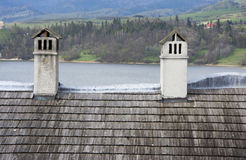 Old roof. Old wooden roof with chimney Royalty Free Stock Image