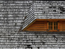 Old roof on a wooden cottage. Background or texture Old roof on a wooden cottage Stock Image