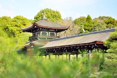 Old roofed bridge in a garden at Heian Jingu of Kyoto royalty free stock photo